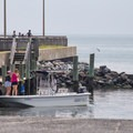 A family pushing off from the boat launch.- Kiptopeke State Park