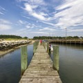 A pier that runs the length of the boat ramp area.- Kiptopeke State Park