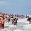 People playing in the surf.- Virginia Beach