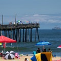 The fishing pier with a large ship in the background.- Virginia Beach