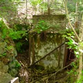 A tower foundation. Possibly the remains of a chairlift system from the downhill ski operation that only lasted from 1958 to 1959.- Cobble Hill
