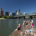 Audrey McCall Floating Dock on the Willamette River with downtown Portland in the background.- Audrey McCall Floating Dock + Beach