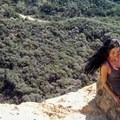 Playing in the small caves.- Santa Ynez Canyon Trail to Eagle Rock