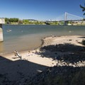 Poet's Beach on the Willamette River and the Marquam Bridge with Tilikum Crossing in the distance.- Poet's Beach