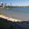 Poet's Beach on the Willamette River and the Hawthorne Bridge and downtown Portland in the distance.- Poet's Beach