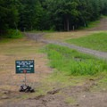 Signs are present to help locate the trailhead.- Stag Brook Trail