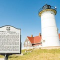 Nobska Lighthouse with a sign of its history.- Nobska Point Lighthouse