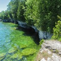 Cliffs along the shoreline in Cave Point County Park.- Cave Point County Park