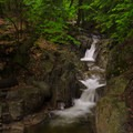 A flume-like waterfall just above the main falls.- Stag Brook Trail