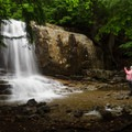 A hiker pauses to capture a photo of this 20-foot block waterfall.- Stag Brook Trail