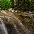 This large slide fall has been worn smooth by the water.- Stag Brook Trail