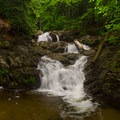 Picnic Table Falls was named by a guidebook author due to the picnic table near its pool. This was done to offer a point of reference.- Stag Brook Trail
