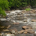 You will cross the bridge that spans the West Branch Ausable River. This is a popular spot for fishermen.- Stag Brook Trail