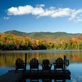 Fall colors surround the lake in October.- Heart Lake Campground