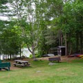 A picnic area where boats are available to take out on the lake.- Heart Lake Campground