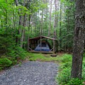 This site has a platform with a roof for small tents.- Heart Lake Campground
