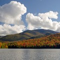 Fall foliage makes Heart Lake a destination location in the fall.- Heart Lake Campground