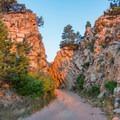 Fowler Trail cuts through a rocky ridge.- Eldorado Mountain