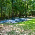 Picnic tables and grill to right of the amphitheater.- Whitten Park Campground
