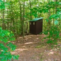 There are several outhouses throughout the campground.- AMC's Cardigan Campsites