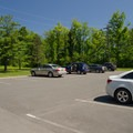 The larger of the two parking lots for the beach.- Thompson's Lake Campground