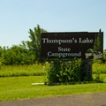 The entrance sign along the main road lets you know you've made it.- Thompson's Lake Campground