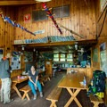 The main dining/gathering room and kitchen.- Zealand Falls AMC Hut