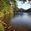 Small inviting beach meets the pristine lake.- Loon Lake East Shore Recreation Site