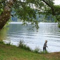 A boy fishing at Loon Lake.- Loon Lake East Shore Recreation Site