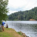 Anglers enjoying the open grassy area on the waterfront at Loon Lake.- Loon Lake East Shore Recreation Site