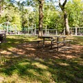 Grills and benches near Goodwill Park playground.- Goodwill Park