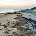 Cars are not allowed pass on this broken section of road next to Herring Cove Beach.- Herring Cove Beach