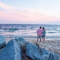Enjoying the romantic sunset at Herring Cove Beach.- Herring Cove Beach