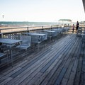 Neck Run Cafe has plenty of available indoor and outdoor seating.- Devereux Beach