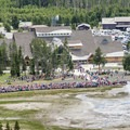 The crowd waits patiently for Old Faithful.- Observation Point