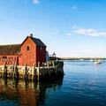 The famous Motif #1 fishing shack in a harbor near Bearskin Neck.- Bearskin Neck