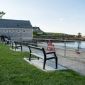 Ample bench seating near the ocean at Rockport Beach.- Front Beach