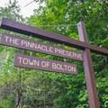 Roadside sign marking the trailhead.- The Pinnacle