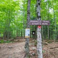 Trail register and the start of the trail.- The Pinnacle