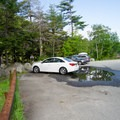 The parking lot can accomodate between seven and eight vehicles. Additional parking is neaby at roadside.- Chapel Pond