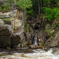 A small waterfall forms on a stream across the river. Above is the Wilmington Notch Campground.- Wilmington Notch Falls