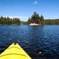 Adventurers enjoy exploring one of the lake's islands.- Bennett Lake