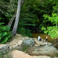 Steps lead down to the swimming hole and waterfall areas.- Wildcat Wayside