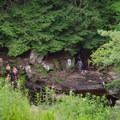 Looking down to the base of the falls. Swimmers and hikers enjoy the refreshing water.- Shelving Rock Falls