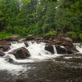 Sawmill Site Falls from the trail on the south side of Trout Brook.- Natural Stone Bridge and Caves Park