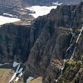 The waterfalls tumble from Swiftcurrent Glacier and snowfields high above.- Swiftcurrent Pass Trail