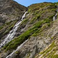 One of the switchbacks passes very close to a pair of waterfalls.- Swiftcurrent Pass Trail