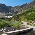 This footbridge marks the beginning of the steep climb to Swiftcurrent Pass.- Swiftcurrent Pass Trail