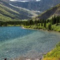 The lake is a worthwile destination all its own, especially on a hot day.- Swiftcurrent Pass Trail