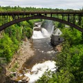 The view of Rainbow Falls and Horseshoe Falls from a lookout along the trail.- Ausable Chasm